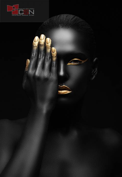 dark-skinned woman with golden make-up.